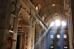 Interior of saint peters basilica with crepuscular rays, vatican city, rome Stock Photos