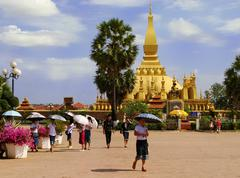 square in front of pha that luang temple complex, vientiane, laos - stock photo