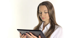 Beautiful girl shows information from the tablet on a white background Stock Footage