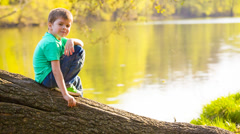 Boy near the water Stock Footage