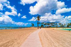 Waikiki shoreline with tourists in Honolulu, Hawaii - stock photo