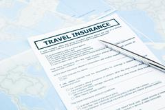 travel insurance form on world map - stock photo