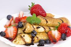pancakes with strawberries and blueberries - stock photo