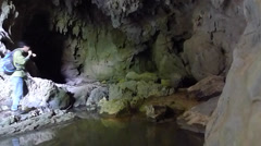 Young man exploring and trekking in a karst cave Stock Footage
