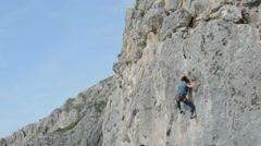 Cristina Pogacean Piolet dor nominee lunges for handhold while rock climbing  in - stock footage
