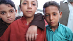 Afghan children looking into the camera - stock footage