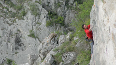 Romanian climber Mihnea Prundean climbing overhanging arete route Stock Footage