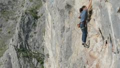 Cristina Pogacean Piolet dor nominee rock climbing at crowded crag in Remetea - stock footage