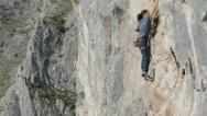 Stock Video Footage of Cristina Pogacean Piolet dor nominee rock climbing at crowded crag in Remetea