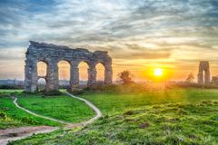 park of the aqueducts at sunset, rome - stock photo