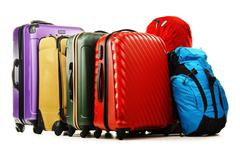 luggage consisting of large suitcases and rucksacks isolated on white. - stock photo