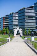 arch entrance in front of modern offices next to budapest national theater - stock photo