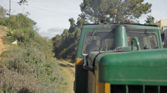 View from a wagon of old-style train. Grass, bushes and unusual tree. Stock Footage