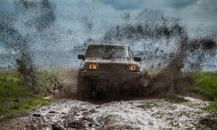 off-road vehicle to advance bravely splashed mud - stock photo
