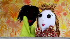 Doll African and Caucasian greet and socialize together Stock Footage