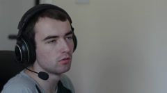 Gamer Talks Online With Headset Stock Footage