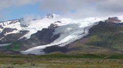 Glacier descends down the valley, moving clouds time lapse Stock Footage