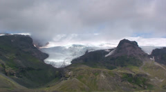 Time lapse clouds over glacier descending down mountains Stock Footage