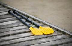 Pair oars on the pier Stock Photos