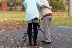 Nurse and disabled with walker Stock Photos