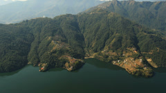 Aerial View: Flight over the mountains, Pokhara Valley, Annapurna area, Nepal. Stock Footage