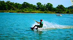 Teenager makes a wakeboarding Stock Footage