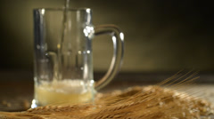 Pint of beer with barley,locked down,bubbles rising up,studio lighting Stock Footage