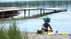 Caucasian baby boy playing on beach, Jasper, Alberta, Canada Stock Footage
