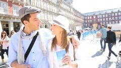 Couple visiting madrid plaza mayor Stock Footage