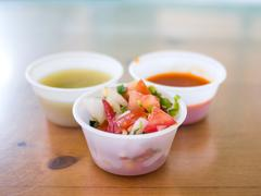 different types of salsa in plastic cups - stock photo