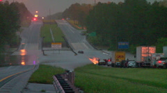 Flooding from record rainfall closes interstate Stock Footage