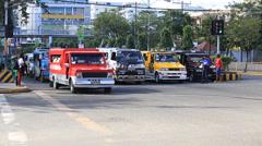 Jeepneys passing, Filipino inexpensive bus service. Cebu, Philippines. Stock Footage