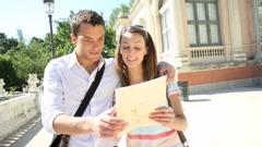 Tourists in madrid retiro park by the palacio de cristal Stock Footage