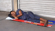 Stock Video Footage of Beggar man sleeping on the street in Cebu city, Philippines