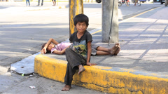 Beggar boys live on the street in Cebu city, Philippines - stock footage