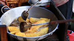 Fruits being fried in a wok, Philippines Stock Footage