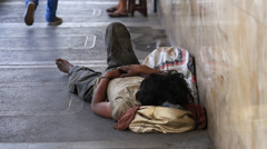 Beggar man sleeping on the street in Cebu city, Philippines Stock Footage