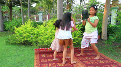 Girls playing portable computer in the park. Stock Footage