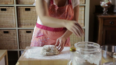 Hispanic woman kneading dough Stock Footage