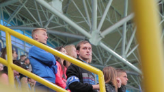 Football fans on the city stadium during the match Dnipro - Carpathians - stock footage