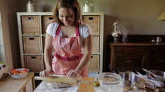 Hispanic woman rolling dough with rolling pin Stock Footage