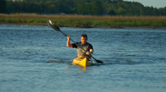 Slow Motion Kayaker coming towards camera stock video clip Stock Footage