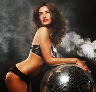 Girl in smoke with disco ball Stock Photos