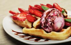 Waffles with strawberry and ice cream Stock Photos