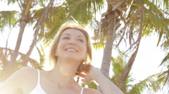 Close up of Caucasian woman under palm trees Stock Footage
