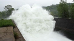 Open dam discharged a large amount of water,close up,tilt up Stock Footage