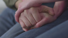 Pregnant Caucasian couple holding hands and stomach Stock Footage