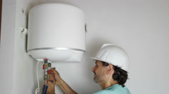 Boiler installation and handyman in boiler room Stock Footage