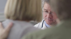 Caucasian doctor talking to couple Stock Footage