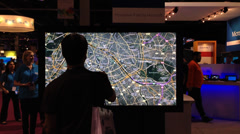 Man Uses Touch Screen Maps App Technology Stock Video - stock footage